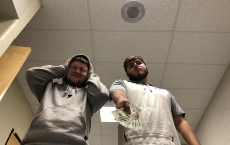 juniors, keith koppenhaver and Justin Witmer hand over money to help stop the annoying Christmas music.