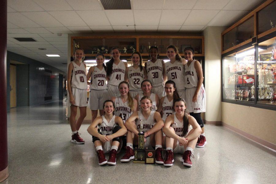 Girls+Basketball+holds+the+third+place+trophy+after+winning+against+Blue+Mountain+Lady+Eagles.