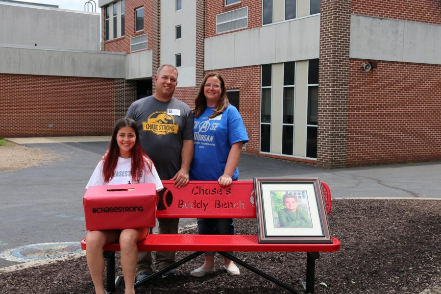 The Morgan family poses at Chase's Buddy Bench.