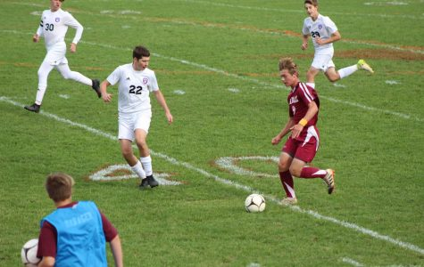Ethan Hannevig takes the ball up the sideline attempting to get around the defender.