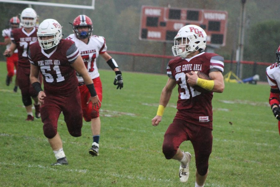 Colin Luckenbill attempts to score a touchdown after a huge block by number 51, Keith Koppenhaver.