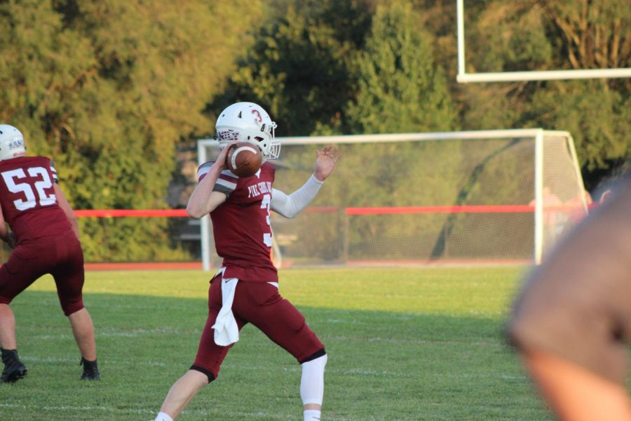 Junior, Josh Leininger rolls out of the pocket to get his pass off during the Week 2 win over Millersburg.