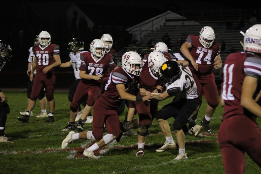 Riley Tobias and Trey Reynolds are protecting Josh Leininger from getting sacked.