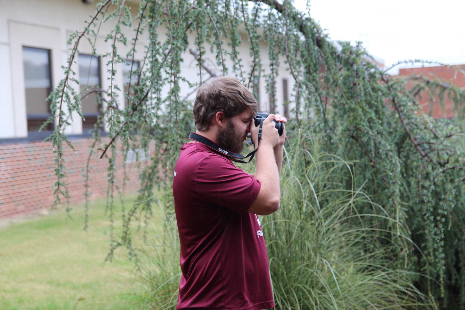 Koppenhaver is taking pictures of a rainy fall day.
