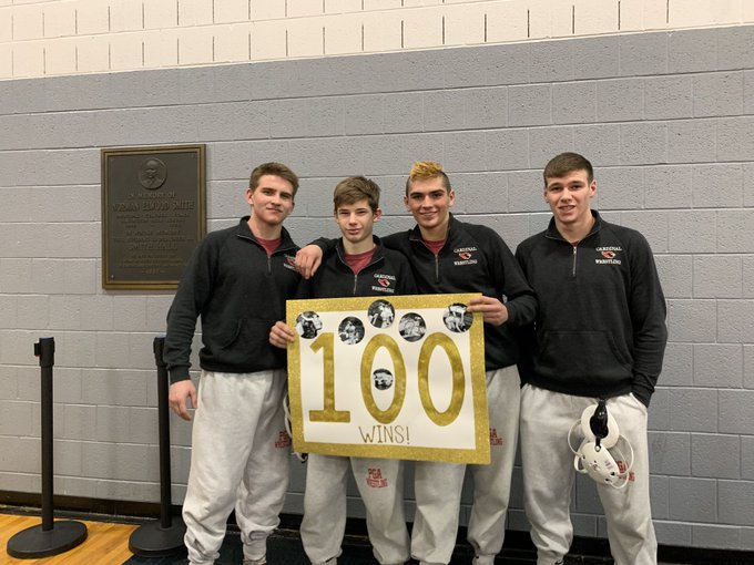 The+senior+wrestlers+posing+with+Travis%27+100th+win+poster+after+the+match.+From+left+to+right%3A+Gavin+Harris%2C+Travis+Anderson%2C+Chris+Charles%2C+Caleb+Reiter.