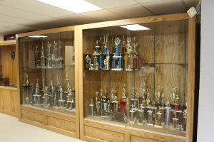 Nate Minnich's two display cases filled with trophies.
