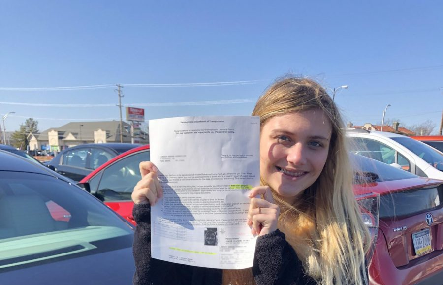 Lindsey Kemmerling posing with her Junior Learner's Permit.