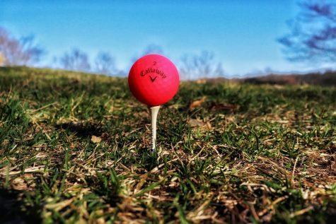 A photograph of a Callaway golfball on a golf tee.