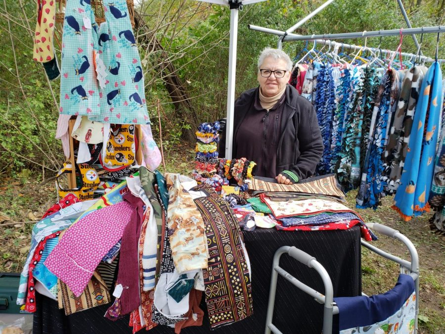 Helen Schannauer stand with her crafts under her tent at the stroll