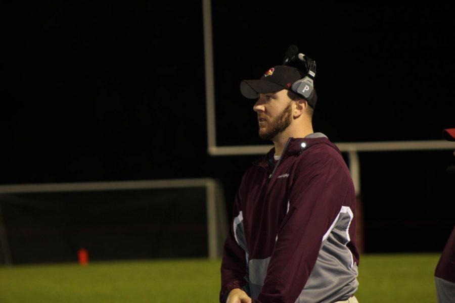 Coach Gaffney signing a play to his quarterback, Josh Leininger.