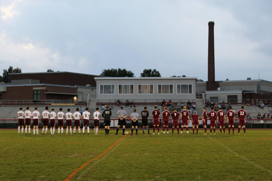 Teams standing for the National Anthem.