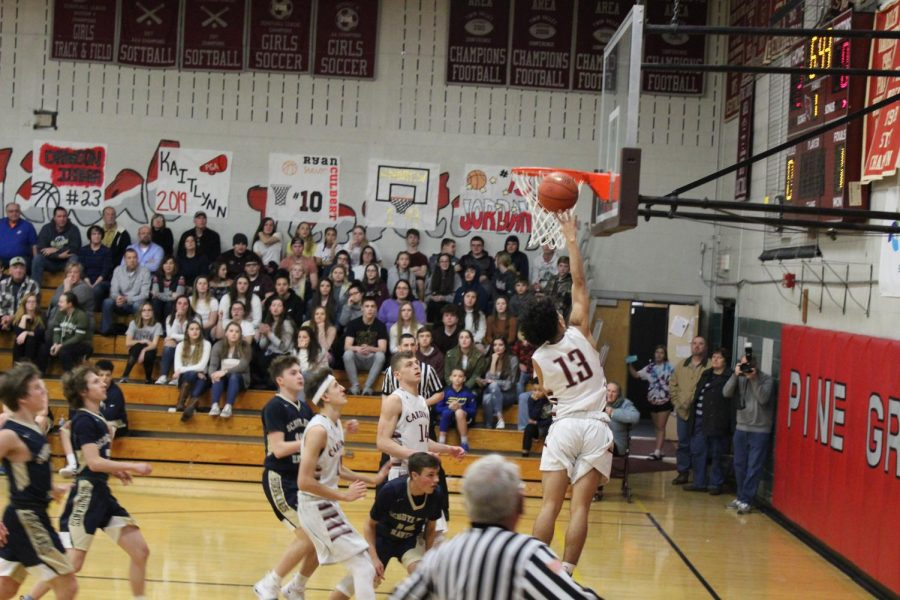 After getting the assist from Andrew Griffiths, Jordan Pena goes up for the layup.
