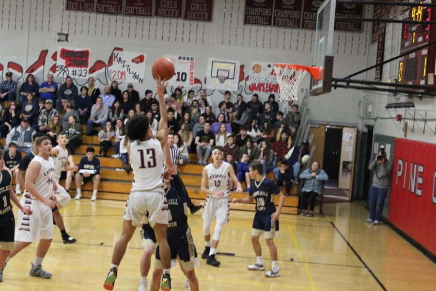 Jordan Pena attempting a floater during the loss against the Hurricanes.