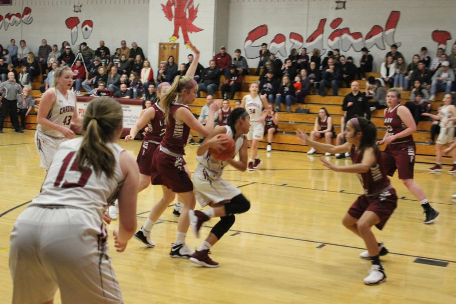Mikaili+Donmoyer+takes+the+ball+past+Pottsville+defender%2C+as+Alli+Butler+looks+for+the+ball+to+get+passed+to+her.