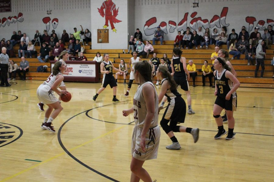 Alli Butler attempting to shoot three pointer against Panther Valley.