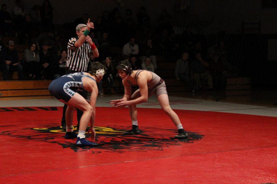Dillon Kintzel starting the match against his opponent.