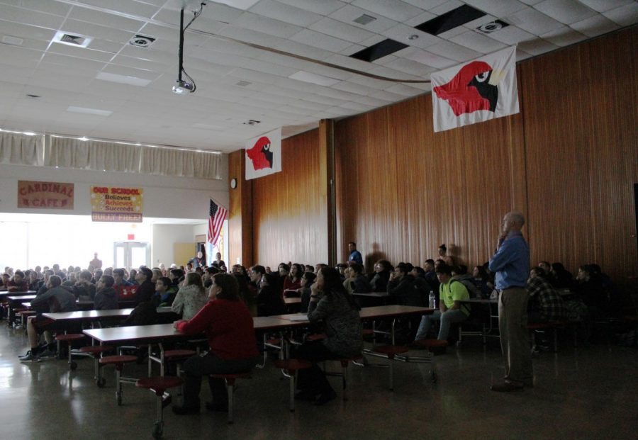 Eighth grade students and teacher listening attentively to Mr. Fitzpatrick from Schuylkill Technology Center.