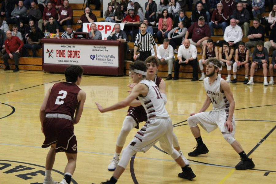 Ryan Culbert and Andrew Griffiths guarding Pottsville players.