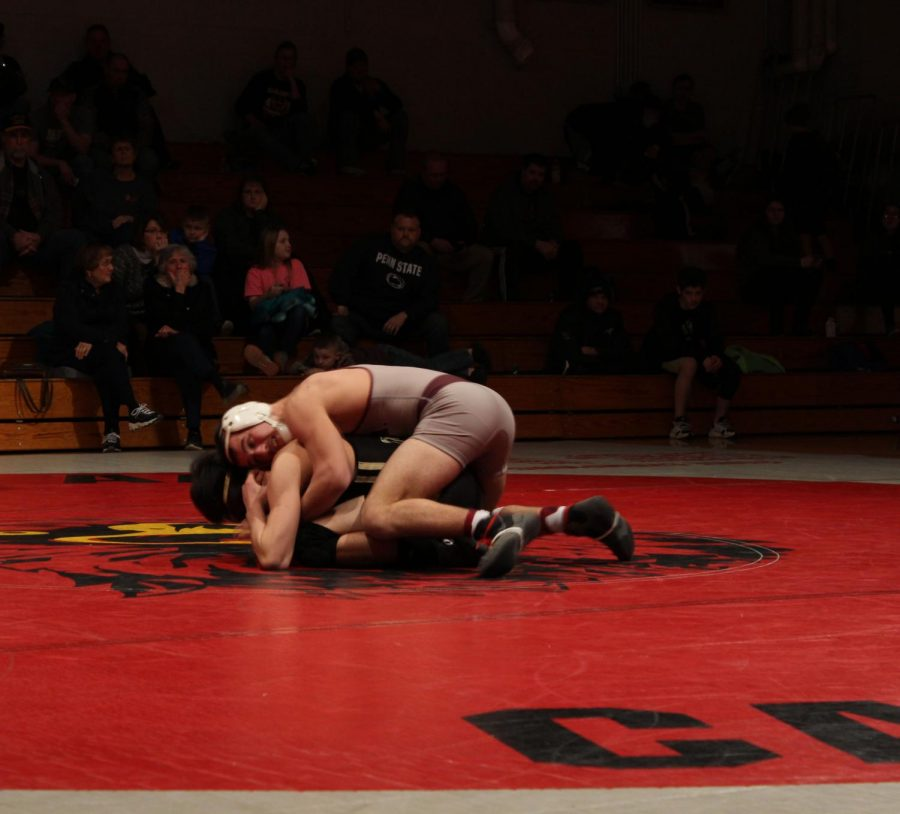 Ayden Ney keeping his opponent on the mat during their match.