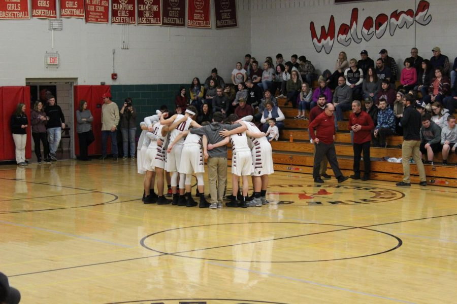 Cardinals in a huddle before playing against Pottsville.