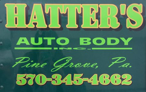 Hatter's Auto Body logo that is on one of their rollbacks.