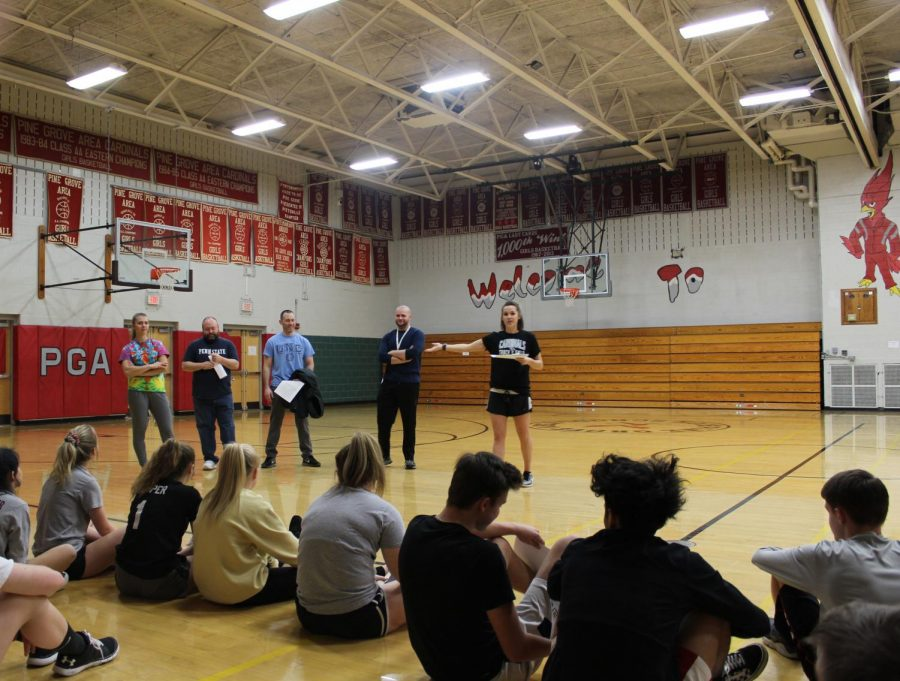 The track coaches, from left to right, Coach Readingher, Coach Salen, Coach Gradwell, Coach Herring, and Coach Daubert, speaking to the 2019 track and field athletes about their expectations.