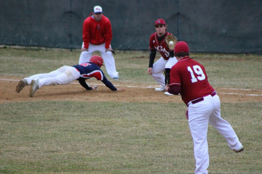 Brandon Aungst, number 19, throws the ball to first baseman, Hunter Heim, in an attempt to throw the runner out.