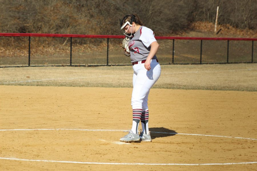 Olivia Lehman is the starting pitcher for the Lady Cards against the Lady Hurricanes.