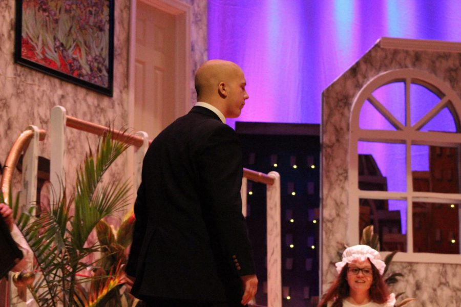 Mr. Warbucks played by Trey Reynolds. He was adopted Annie.