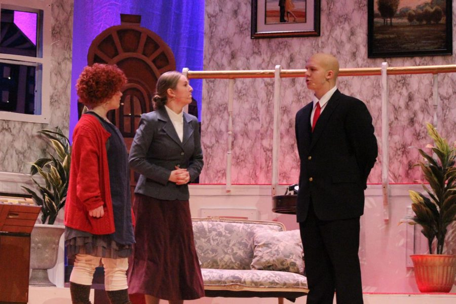 Mr. Warbuck and Grace, played by Angela DiFalco, talking to Annie, played by Morgan Flick.