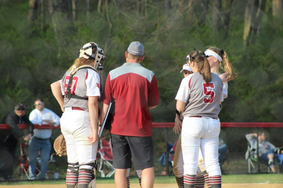 Coach Leffler is visiting the mound to talk to his team during the win over the Crimson Tide.