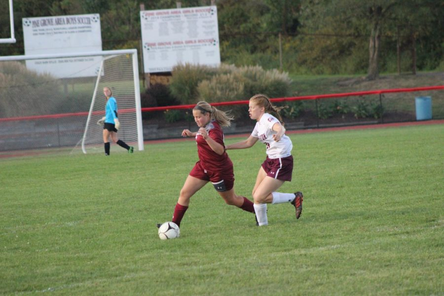 Kallie Wolfe cuts off Leighton player to take possession.