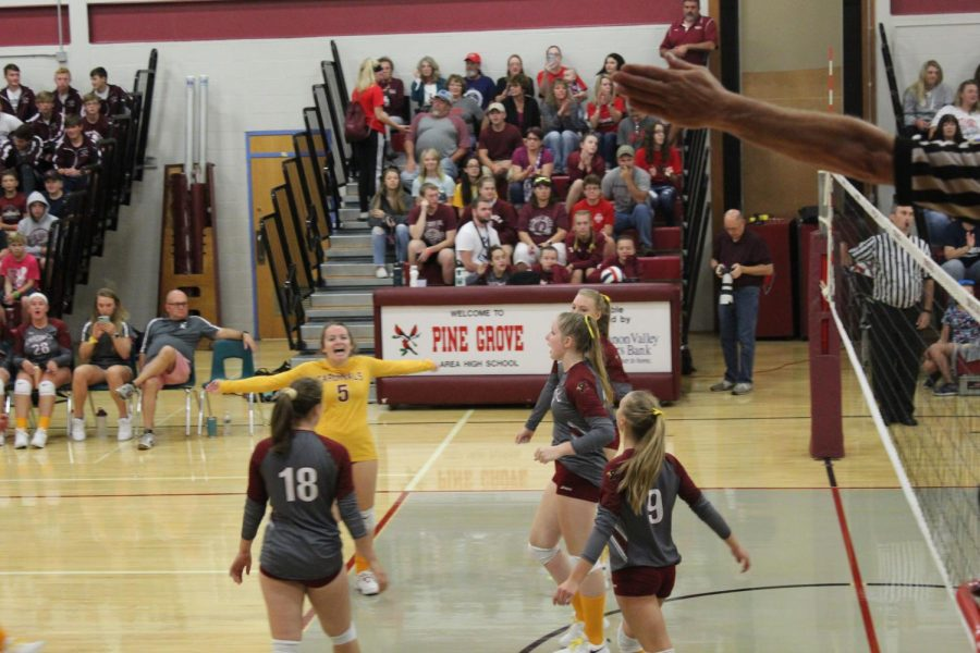 """After scoring off a serve the varsity team yells """"ACE"""