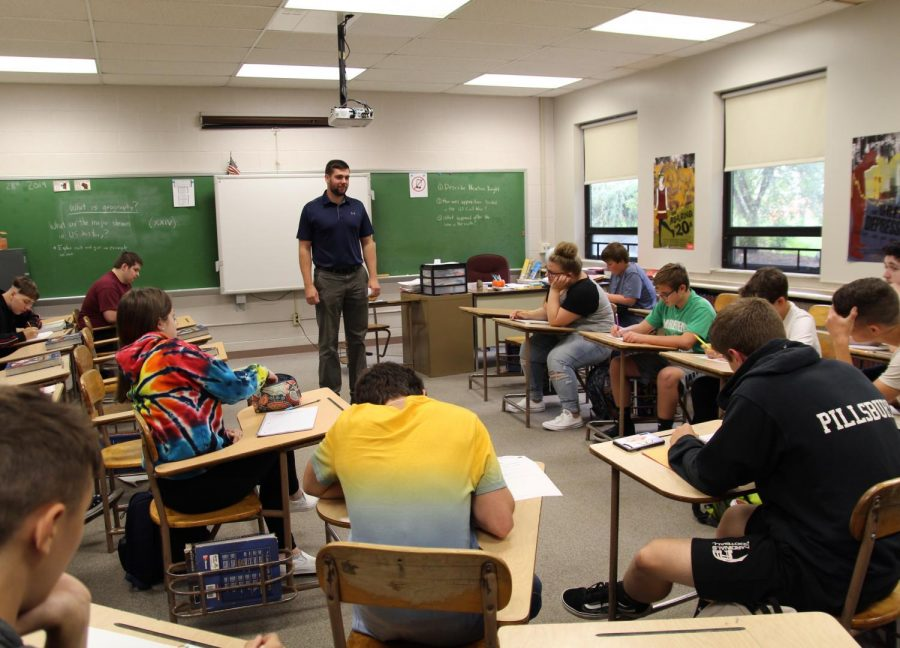 New teacher, Mr. Burke, teaches history to one of his classes.