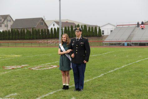 Angela DiFalco being escorted by Sgt. Aidan Crochuinus.