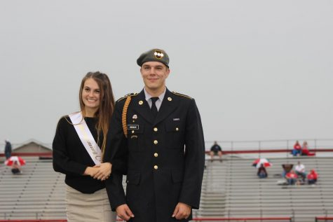 Tessa Olt being escorted by Captain Ethan Hindman.