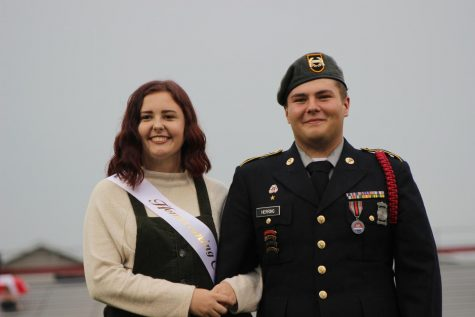 Meghan Sarge being escorted by SSGT Toby Herring.