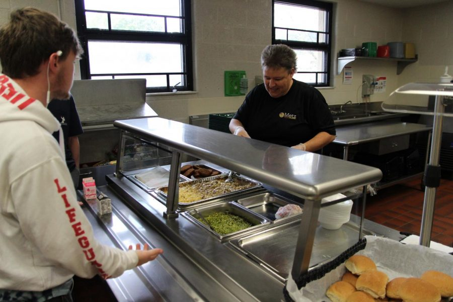 Pine Grove Area High School Student waits to get lunch from the cafeteria staff.