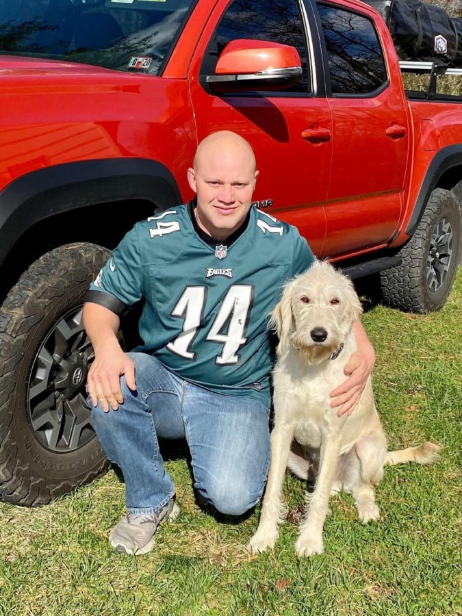 Ted Kemmerling poses with his truck and his dog, Ferris.