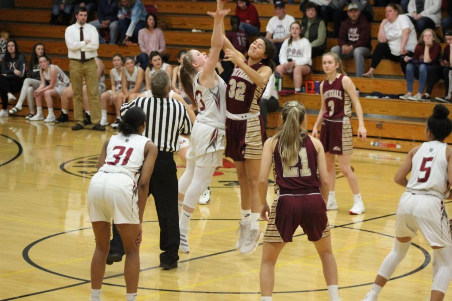 Abbie Brown winning the tip-off for the Lady Cardinals.