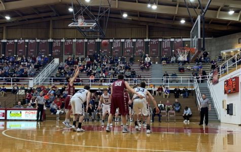 Dalton Geesey shoots free throw in his first ever district game.