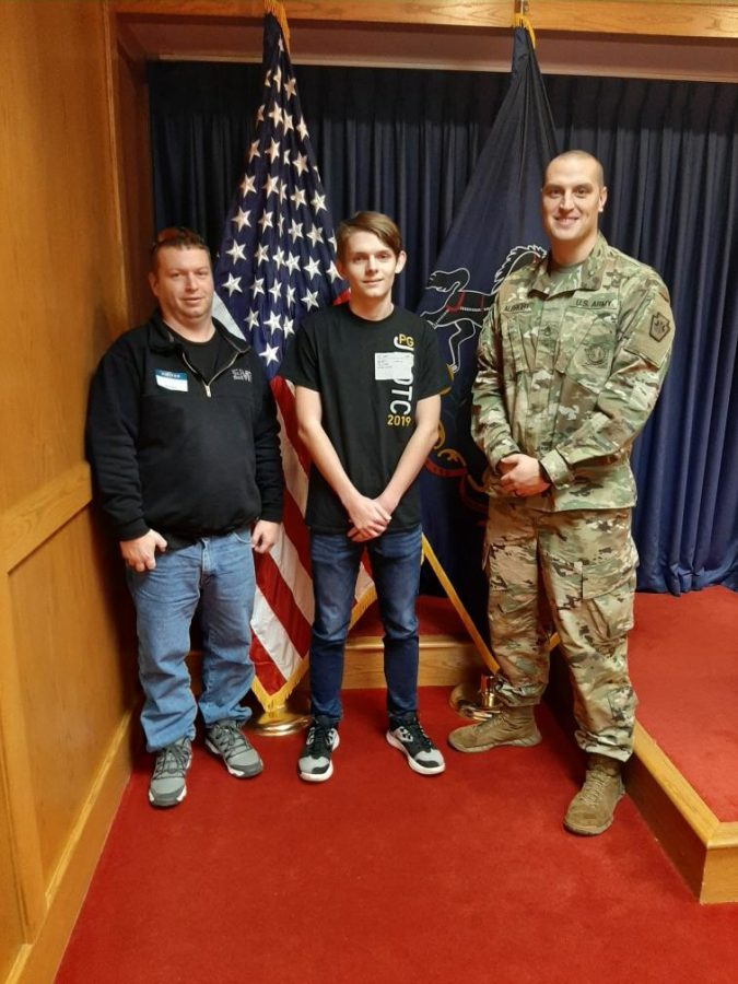 Damion+Williams%2C+his+father%2C+and+Staff+Sergeant+Albright+after+Damion+swore+into+the+Pennsylvania+National+Guard.