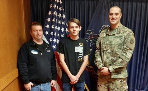 Damion Williams, his father, and Staff Sergeant Albright after Damion swore into the Pennsylvania National Guard.