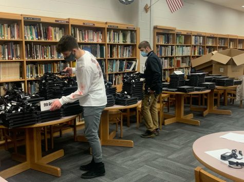 Aaron Balmer and Cj Keeting working on Chromebook distribution.