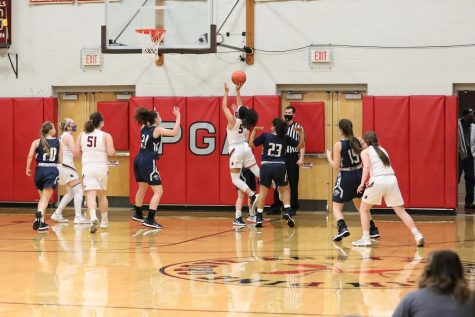 Mikaili Donmoyer runs through a defender to attempt a layup.