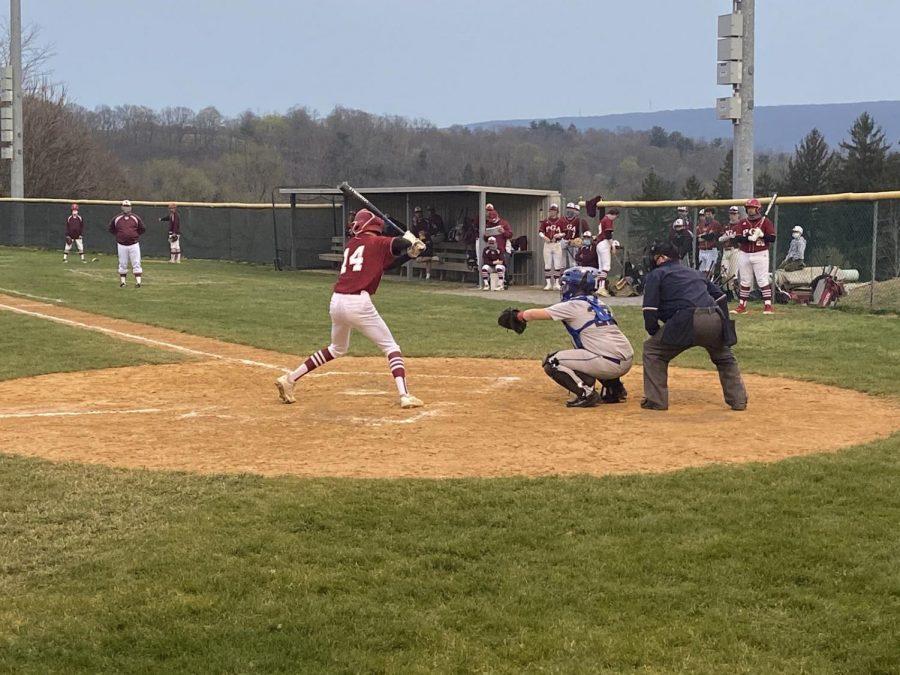 Hunter Deichert, junior, #14 up to bat.