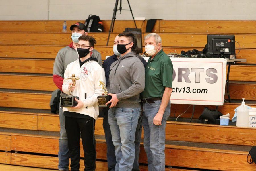 A photo of Brody Robinson, senior and Shea Morgan, senior, after receiving their awards.