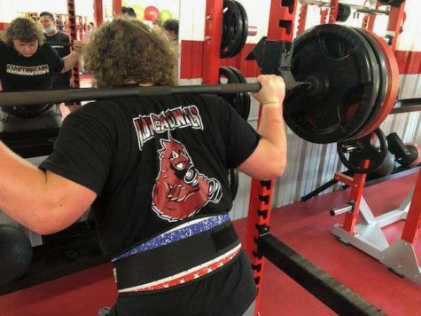 Sophomore, Carter Raudabaugh, squatting weights preparing for the first ever Cardinal Lift-A-Thon.