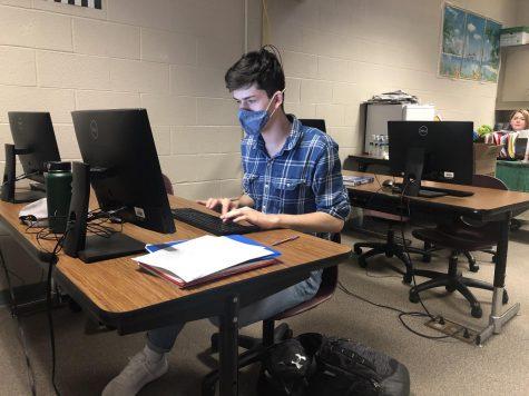 Senior Erik Dubbs typing an essay for a class.