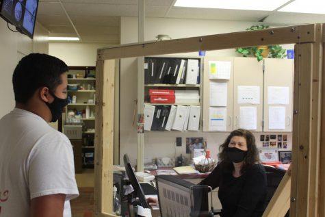 Colin Ibarra, junior, talking to the High School Principal's Secretary, Mrs. Melanie Daubert.